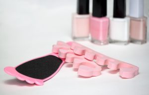 Pedicure set in pink shades of colour ready for pampering